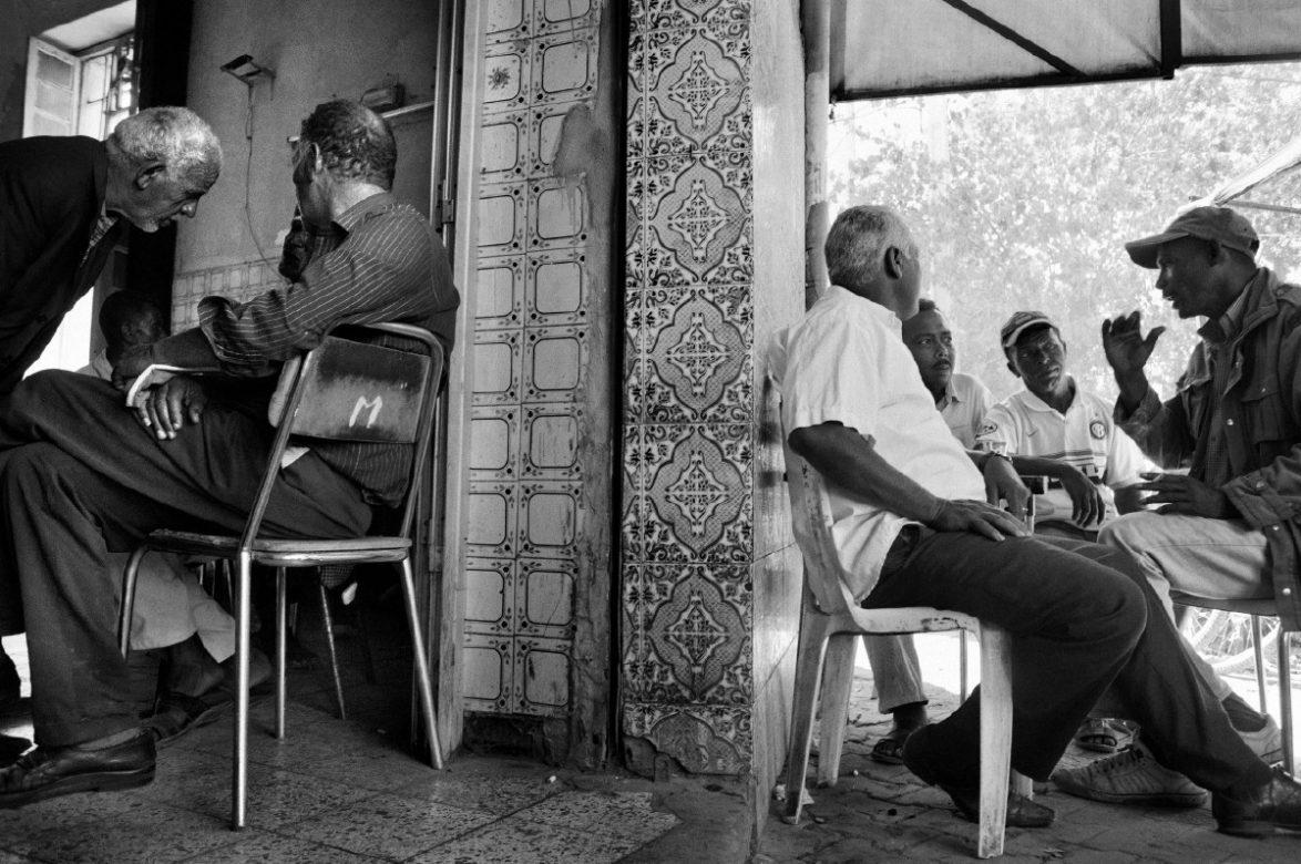 Men sit in a Jendouba café. Jendouba, 2013. Tunisia.
